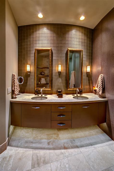 contemporary bathroom with floating vanity and limestone