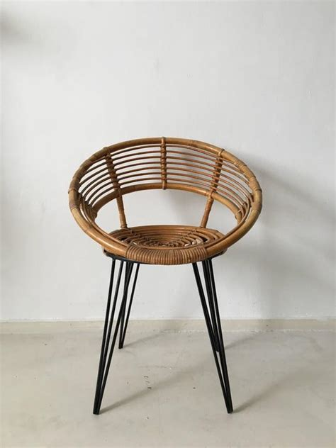 rattan chair with metal hairpin legs circa 1950s