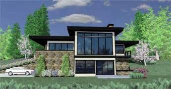 front sloping lot house plans pacific northwest style adapts architectural designs to the landscape