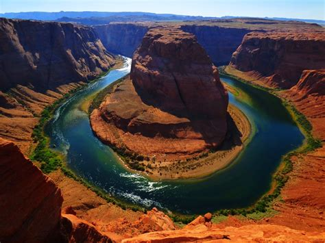 how is sand that flows in a river formed geotripper a rock outcrop a river and sand flow into a