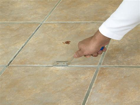 Removing Grout From Porcelain Tile how to replace a broken floor tile how tos diy