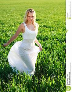 Romantic Woman In Dress Running Across Green Field Stock ...