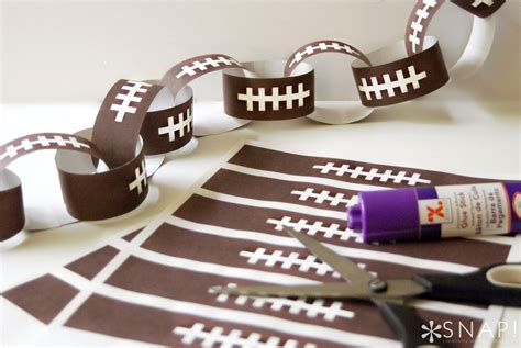 Print + Cut Football Paper Chain  Tauni + Co. Room Divider Bookshelf. Tall Wall Decor. Decorating Accessories. Dining Room Arm Chairs. Dining Room Credenza. Electric Fireplace Living Room. Wine Decor For Dining Room. Rooms To Go Dining Room Chairs