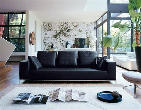 living room with black leather sofa decosee