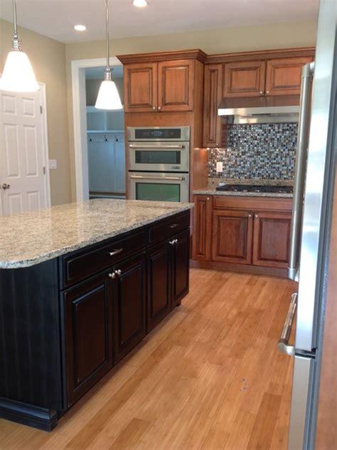 maple kitchen island maple glazed kitchen cabinets with black painted island