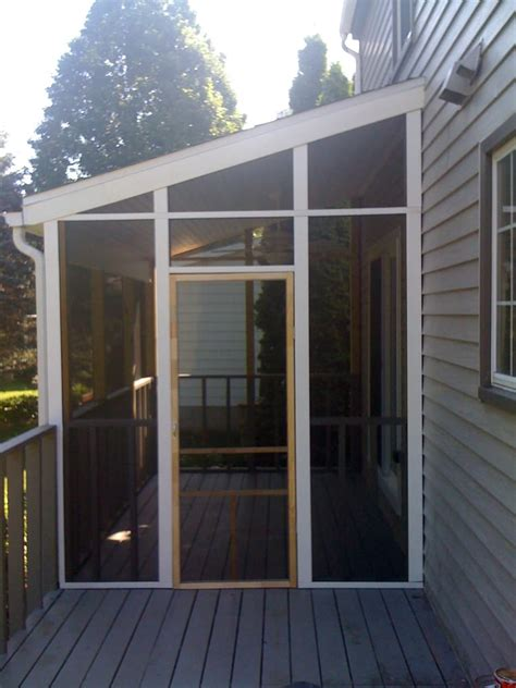 a simple screen porch addition built on an existing deck