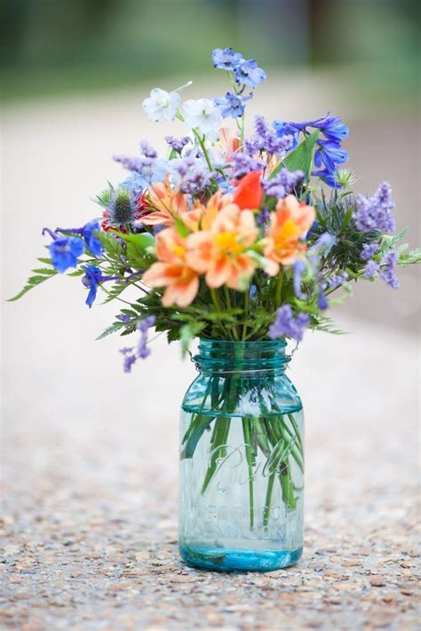 flowers in jars wedding flowers in blue mason jars wedding flowers pinterest receptions wedding and