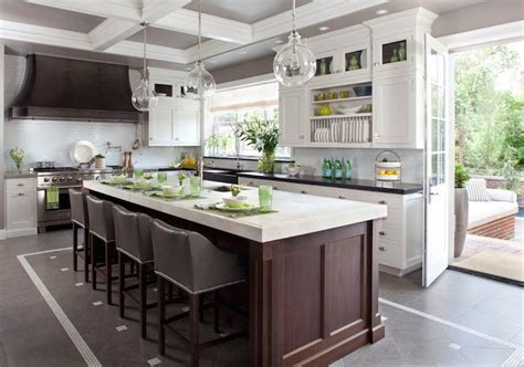 mystery island kitchen white perimeter cabinets w black counters stained 1025