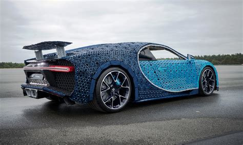Baptized bugatti chiron sport, it arrives with no change in power or performance data, but with significantly improved handling thanks to the addition of new lightweight wheels, and increased use of carbon fiber, including on the windscreen wiper, the new bugatti chiron sport is 18kg (40lbs) lighter. Lego Bugatti Chiron is a life-size toy that can actually be driven