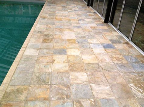 cleaning indian sandstone tiles around an indoor swimming