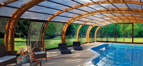 abri piscine bois lamelle colle abris de piscine bois cintr 233 s abri piscinebelgique abrisud fabricant abri de piscine en