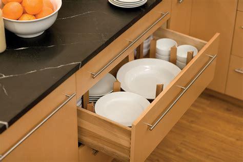 storing plates dishware cabinet kitchen cabinetry plate storage plateware organization