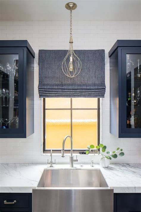 blue pantry cabinets  stainless steel apron sink