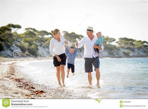Happy Family Together Hand In Hand On The Beach Stock Photography