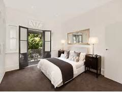 Bedroom Carpeting Ideas by Modern Bedroom Design Idea With Carpet French Doors Using Beige Colours