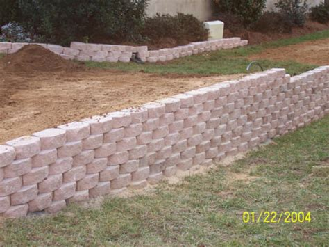rock retaining wall cost cost install build retaining walls erosion control residential yard timber wood lake wall