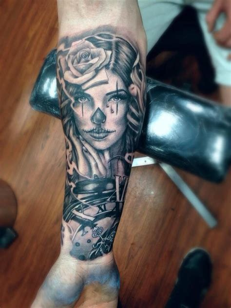 man forearm mexican tattoo  woman rose  time