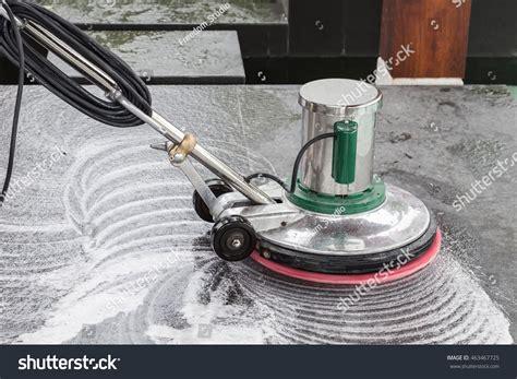 exterior black floor cleaning polishing stock photo