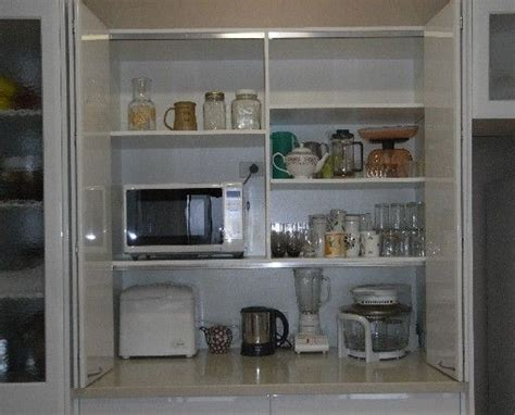 Appliance Cupboards by Appliance Cupboard To Bifold Doors And Shelves