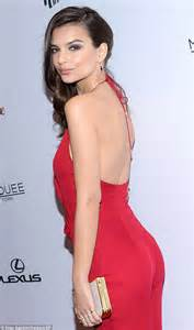 Emily Ratajkowski turns heads in plunging red jumpsuit at ...