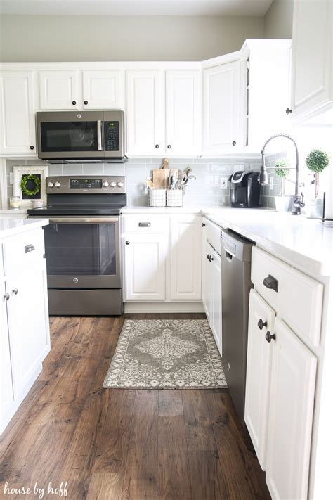 laminate flooring kitchen cabinets how our laminate floors are holding up almost 2 years 8871