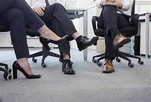 Three Business People With Legs Crossed Sitting On Chairs ...