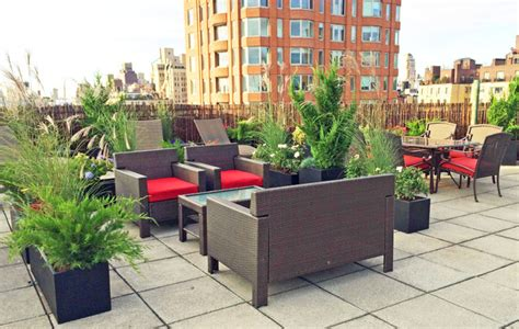upper east side nyc roof deck wicker furniture container plants grasses contemporary
