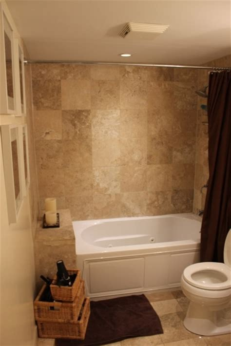 tile tub wall matches floor color scheme browns tans