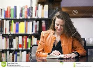 Woman Reading Book In Library Royalty Free Stock Photo ...
