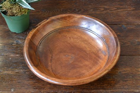 Typically oversized, this type of decorative dish is the perfect finishing touch. 11 Lathe turned bowl coffee table centerpiece medium dark wood | vintage home goods