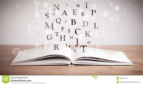 opened book  flying letters royalty  stock