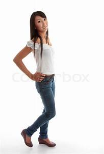 Beautiful young girl wearing skinny leg denim jeans and a white ruffled top | Stock Photo ...