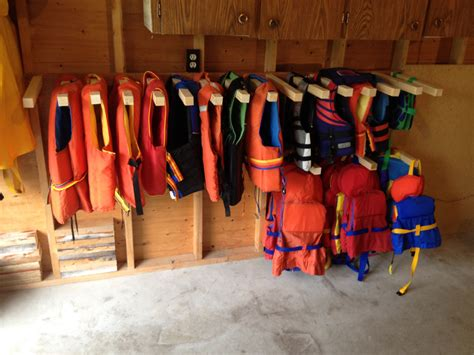 jacket storage ideas space saving life jacket rack lake pinterest spaces lakes and cabin