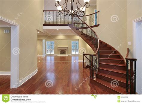 foyer  balcony  curved staircase royalty  stock