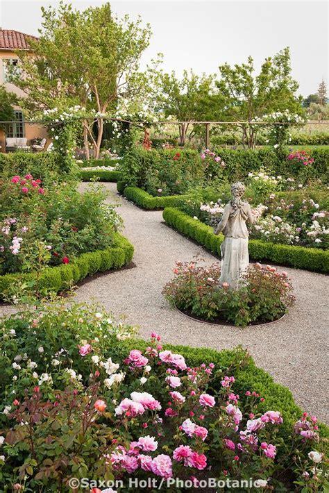 Gravel Path Through California Flower Garden With Statue