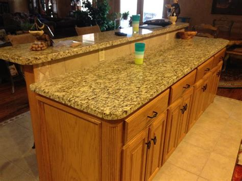 raised kitchen island island with raised seating area surface facing the living 1714