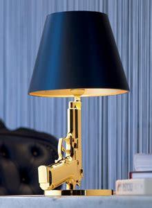 gun bedside table lamp  gold  black lamp shade flos