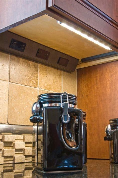 Hidden kitchen outlets and under cabinet lighting