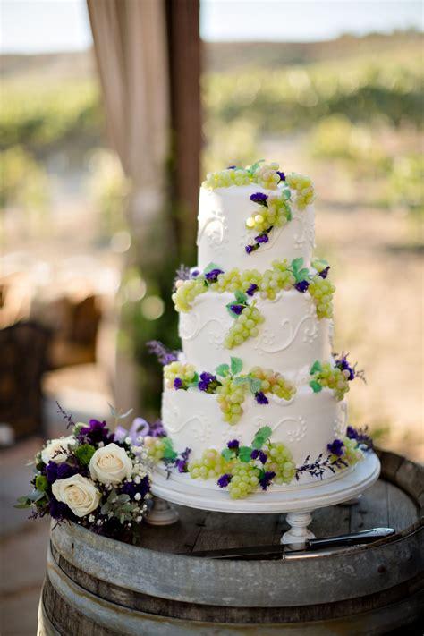 ivory wedding cake accented  grape decor