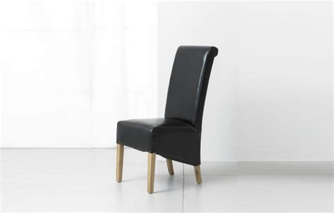 black oak and bonded leather dining chair arika bespoke