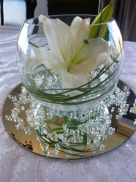 table centrepiece lily with clear water pearls grass