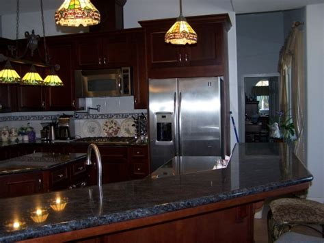 gray kitchen walls with cherry cabinets cherry cabinets with blue grey walls kitchens 8348