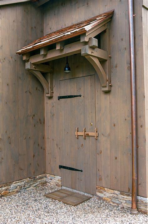 barn door  timber frame eyebrow roof house
