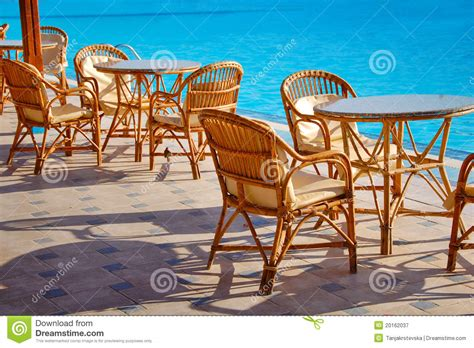 table and chairs by the pool royalty free stock