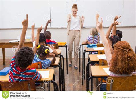 teacher giving  mathematics lesson  classroom stock