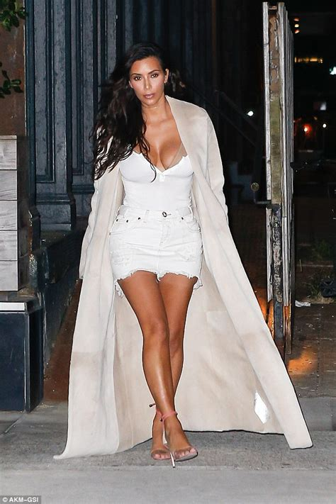 Kim Kardashian steps out in plunging top and denim skirt ...