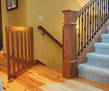 stairway gates - custom wood staircase safety gate with bottom wheel