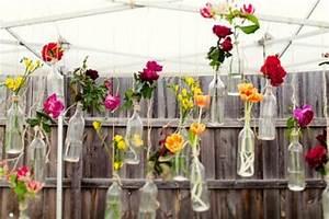 Una decoración primaveral con botellas y flores Paperblog