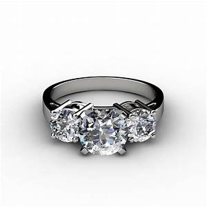 three stone round cut engagement ring With circular wedding rings
