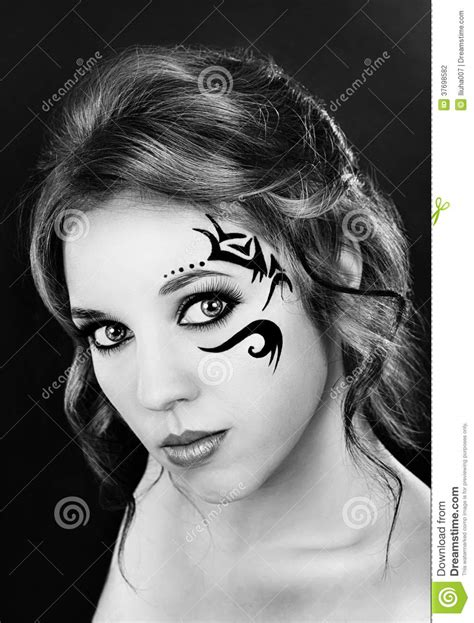Beautiful Girl With A Tattoo On His Face Stock Photo - Image: 37698582